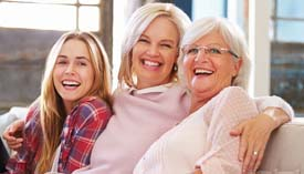 Three women from three generations pose for the photo.
